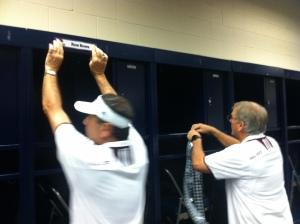 Silva, right, labeling lockers pre-game