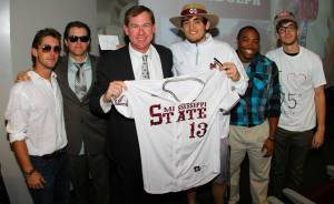 Zac Randolph, dressed as John Cohen, receives his jersey from Commissioner Cohen
