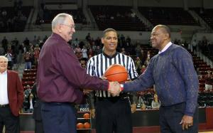Re-enactment of the Game of Change handshake at the MSU-Loyoal 50-year reunion in The Hump Sunday afternoon. Very cool moment.