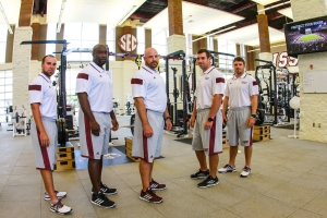 Rick Court, center, with his strength staff