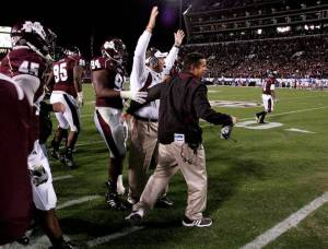 Diaz, right, celebrates with Dan Mullen, center, after beating Kentucky in Starkville in 2010.