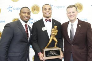 Stricklin with quarterbacks coach Brian Johnson, left, and Dak Prescott, center, after Prescott won the Conerly Trophy