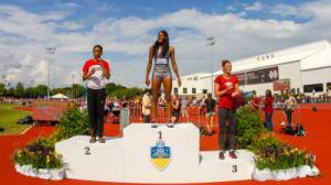 Bougard receiving her first-place medal in the heptathlon Friday