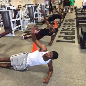 Malik Newman, front, and IJ Ready, second, go through summer workouts