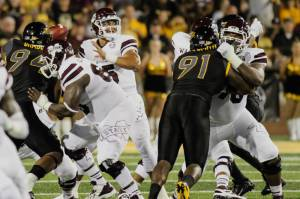 Malone, right, blocking against Southern Miss in the 2015 season opener