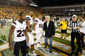 Calhoun, left, on the field with fellow captains before MSU's season opener