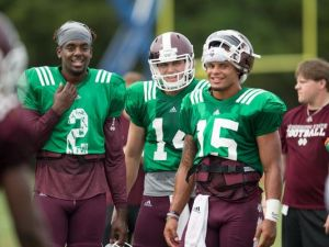 Staley, left, with teammates. Photo courtesy Clarion-Ledger, Keith Warren
