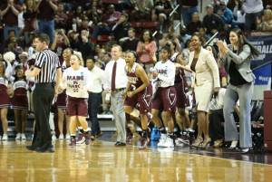 Baker, far right, and Harris, second from right, celebrating as the Bulldogs beat Michigan State