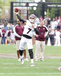 Nick Fitzgerald passing while Mullen and Johnson observe