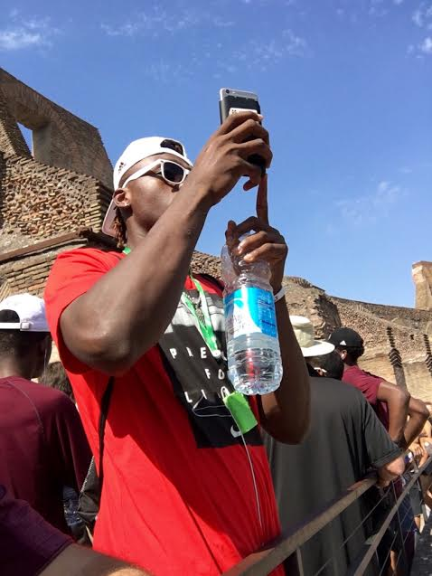 Freshman Schnider Herard capturing a panoramic shot of The Coliseum