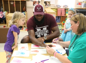 10-31-16 FB  Football players at the Child Development and Family Studies Center (the child-study laboratory for the School of Human Sciences) Photo by Kelly Price
