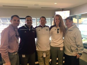Wetherbee, center, with staff members in Boston for MSU's game against UMass
