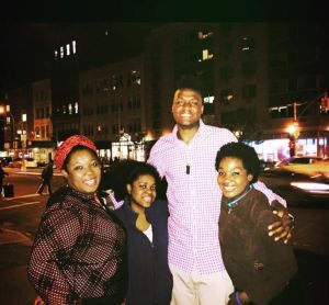 Herard in 2015 with his aunt, sister and cousin, reunited in the U.S. for the first time in years